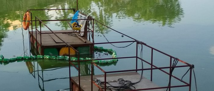 Operation of Submersible dredgers attached to floats at ICF Lake, Villivakkam in Chennai, Tamil Nadu.